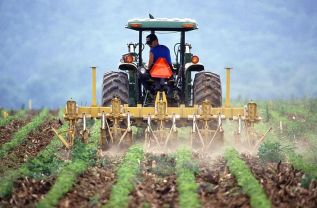 800px-farmer_and_tractor_tilling_soil